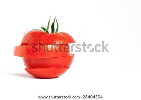 sliced ripe tomato slices on a white background - stock photo
