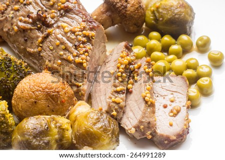 Sliced roast beef with grilled vegetables on white plate. Close up eco food menu background - stock photo
