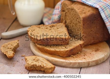 Sliced rye bread and milk - stock photo