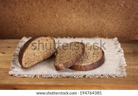 sliced rye bread on napkin - stock photo