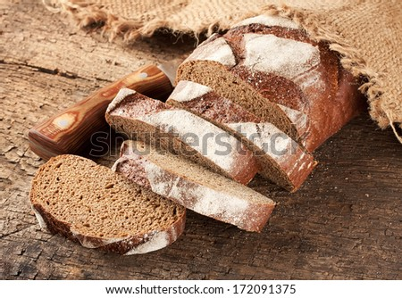 Sliced rye bread with a knife on the table