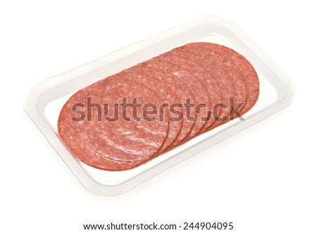 Sliced sausage in the package isolated on a white background - stock photo