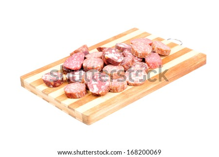 sliced sausage on cutting board isolated on white background   - stock photo