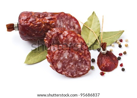 Sliced ??sausage with spices isolated on white background - stock photo
