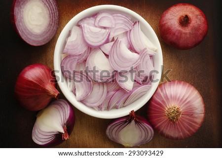 Sliced shallot onion in white bowl - stock photo