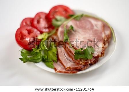 sliced smoked ham on white - stock photo