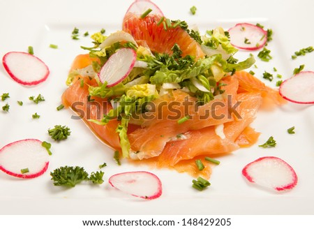 sliced smoked salmon salad with blood orange and radish. seafood appetizer - stock photo