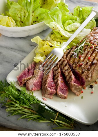 sliced steak with green salad - stock photo