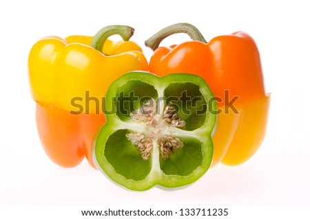 Sliced sweet bell peppers with seeds - stock photo