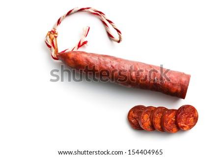 sliced tasty chorizo sausage on white background - stock photo