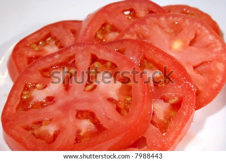 Sliced tomato in dish