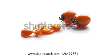 Sliced �¢??�¢??tomato on a white background.
