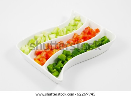 Sliced Tomatoes, Cucumber and Capsicum Salad served in a platter - stock photo