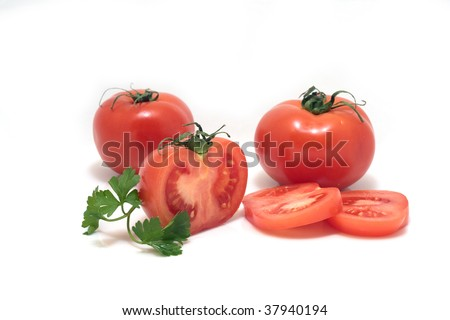 Sliced tomatoes over white - stock photo