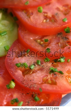 Sliced tomatoes with a dill - stock photo