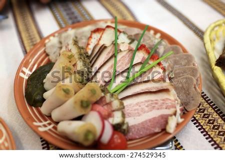 Sliced various bacon on the plate in the ukrainian restaurant - stock photo