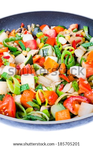 Sliced vegetables in the pan isolated on white background - stock photo