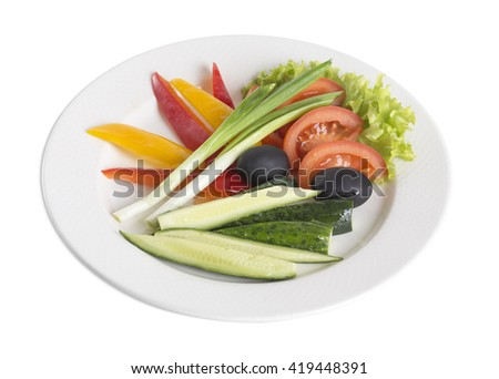Sliced vegetables on a plate. Isolated on a white background.