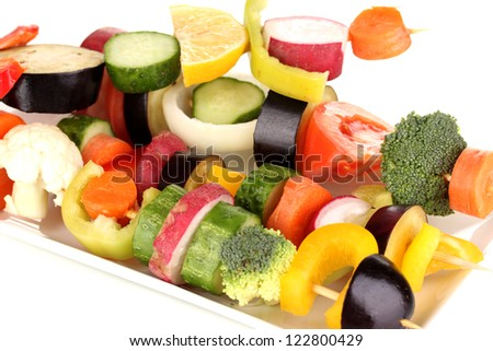 Sliced vegetables on wooden picks close up - stock photo