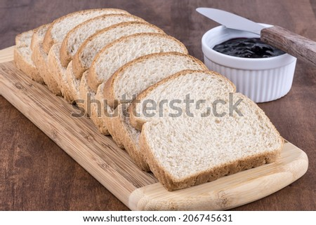 sliced wheat bread with jam - stock photo