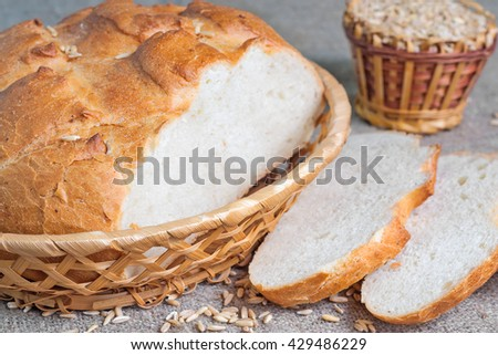 Sliced white bread and seeds of oats