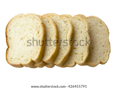 Sliced white bread for making toast and sandwiches. Slices of fresh white bread isolated on a white background. - stock photo