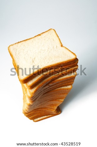 Sliced white bread for toasts on white background.