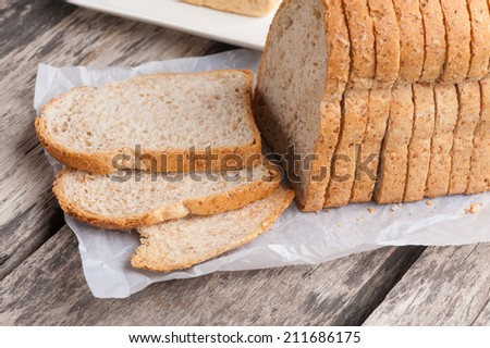 Sliced whole wheat bread on table. - stock photo