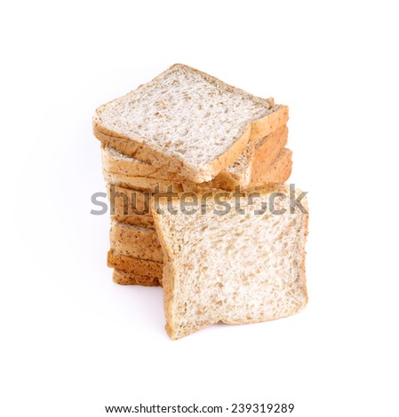 Sliced whole wheat bread on white background - stock photo