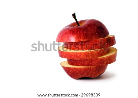 slices of an apple put together to form a hybrid fruit, shot on white in a studio - stock photo