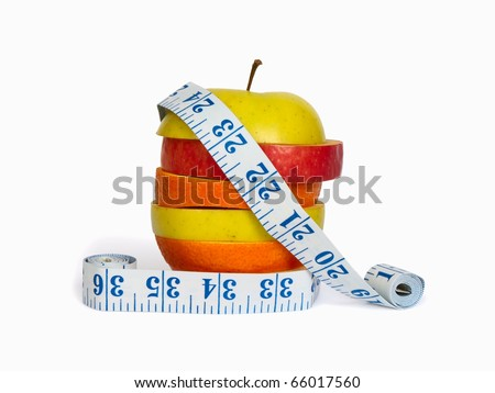 Slices of apples and orange as one fruit and a measuring tape. Isolated with clipping path.