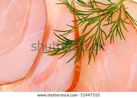 Slices of bacon as background and dill - stock photo