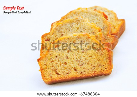 slices of banana cake and fork on white background - stock photo