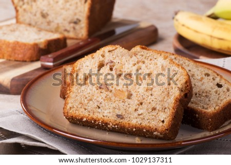 Slices of banana nut bread on a plate