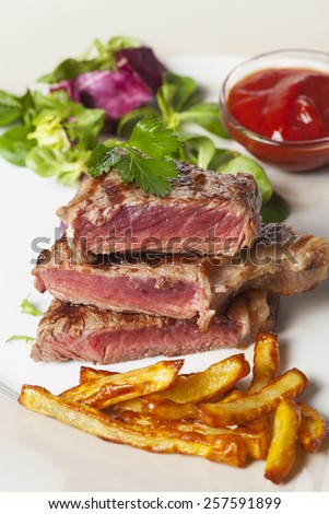 slices of beef steak with fries  - stock photo