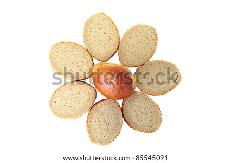 Slices of bread laid out by a flower - stock photo