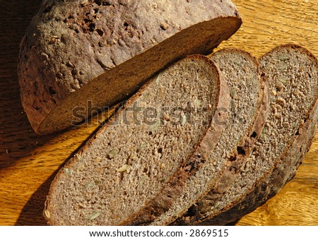 Slices of bread on the table - stock photo