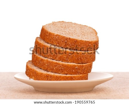Slices of bread with bran for sandwich on a plate over white background - stock photo