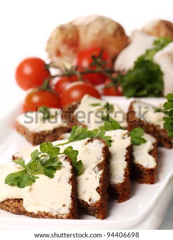 Slices of bread with cream cheese and fresh vegetables - stock photo