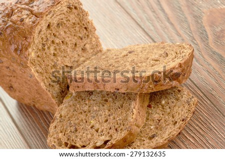 Slices of brown bread on table