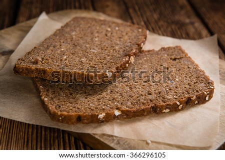 Slices of  Brown Bread (selective focus) on an old wooden table