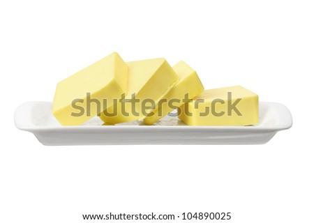 Slices of Butter on White Background - stock photo