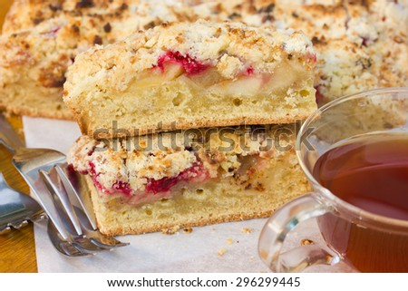 Slices of cake with raspberries, apples and crisp - stock photo