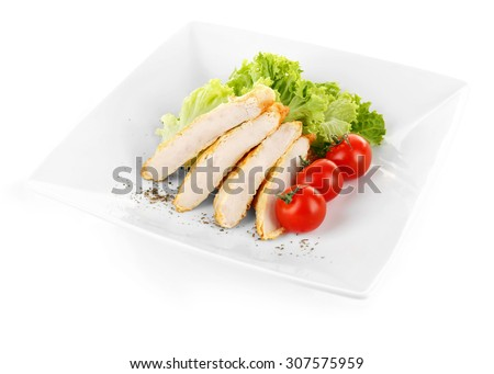 Slices of  chicken fillet with cherry tomato and lettuce on plate isolated on white - stock photo