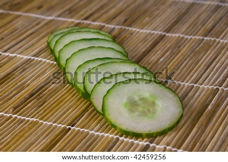 Slices of cucumber closeup shoot on bamboo mat background