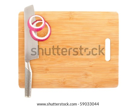 Slices of cut onion and a stainless chef's knife on a board - stock photo