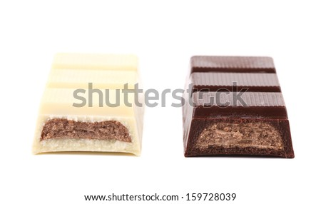 Slices of dark and white chocolate. Close up. Isolated. On a white background - stock photo