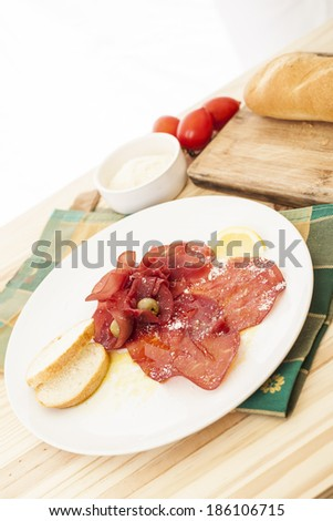 Slices of dried beef on white background