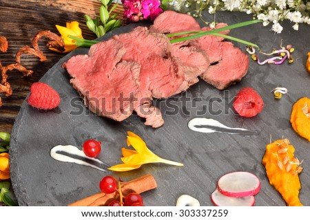 slices of duck fried meat in fancy food arrangement - stock photo