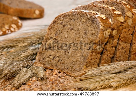Slices of finest organic bread decorated with natural cereals - stock photo